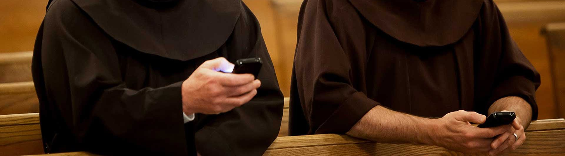 Franciscan friars with smart phones